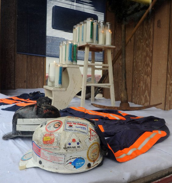 A memorial of miners' gear and candles representing each of the miners confirmed deceased is seen in Nuttin Special restaurant in Whitesville, West Virginia on April 8, 2010. Four miners remain unaccounted for after an April 5 explosion at the mine operated by Performance Coal Company, a subsidiary of Massey Energy. Twenty five men are confirmed dead and two others are in hospitals. UPI/Roger L. Wollenberg