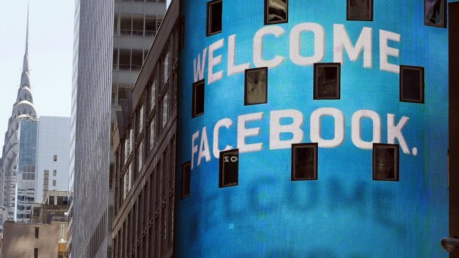 The Chrysler building stands near the Nasdaq building on the day of the Facebook IPO in Times Square in New York City on May 18, 2012. (FB). UPI/John Angelillo