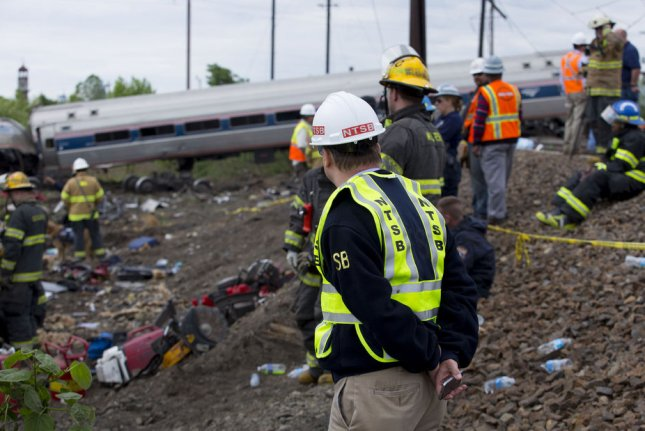 Member Robert Sumwalt on the scene of the Amtrak Train #188 Derailment in Philadelphia, PA. At least six people were killed and over 140 people hurt after an Amtrak train, carrying 238 passengers and five crew members derailed and rolled onto its side in the Port Richmond section of Philadelphia on May 12. Photo by NTSB/UPI