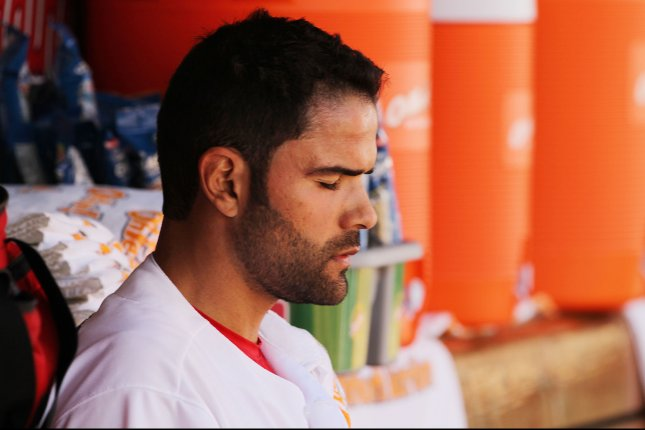 St. Louis Cardinals' Jaime Garcia apears to be in deep thought as he sits in the dugout in the third inning against the Milwaukee Brewers at Busch Stadium in St. Louis on April 14, 2016. St. Louis won the game 7-0 on a one hiter by Garcia. Photo by Bill Greenblatt/UPI