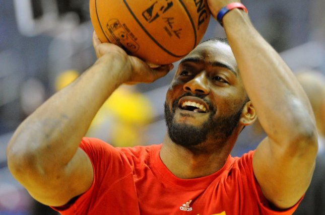 Washington Wizards guard John Wall (2) warms up prior to the game against the Golden State Warriors at the Verizon Center in Washington, D.C. on February 3, 2016. Photo by Mark Goldman/UPI