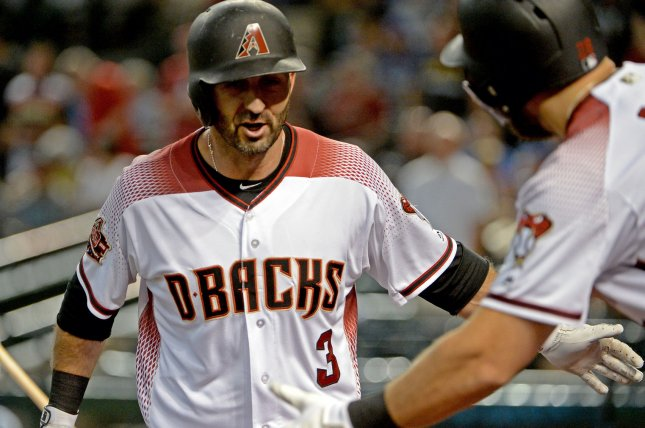 Arizona Diamondbacks' Daniel Descalso is congratulated after hitting a two run home run in the first inning against the Milwaukee Brewers on May 16 at Chase Field in Phoenix. Photo by Art Foxall/UPI