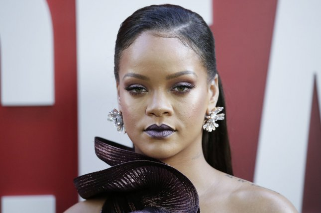 Rihanna has sued her father for false designation of origin, false advertising and invasion of her rights of privacy and publicity. File Photo by John Angelillo/UPI