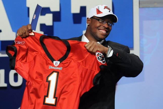 Gerald McCoy celebrated joining the Tampa BAy Buccaneers when he was drafted in 2010. McCoy says he'll play somewhere this season, whether it's with the Buccaneers or another team. File Photo by Roger L. Wollenberg/UPI