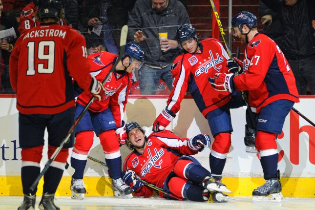 Washington Capitals left wing Alex Ovechkin (8) falls to ice after scoring against the Toronto Maple Leafs in the first period at the Verizon Center in Washington, D.C. on March 1, 2015. Photo by Mark Goldman/UPI