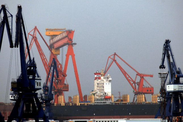Old Chinese gantry cranes unload a giant container ship in the country's northeast port city Dalian, China. China's General Administration of Customs announced Wednesday trade with North Korea totaled $491.8 million in March. File Photo by Stephen Shaver/UPI