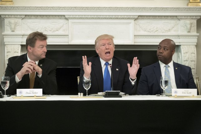President Donald Trump, pictured next to Sen. Tim Scott, R-S.C., (R) on July 19, reiterated late Thursday remarks he made immediately after the violent clashes in Charlottesville, Va., on Aug. 12. The comments were in reference to a meeting he held with Scott Wednesday. UPI Photo/File