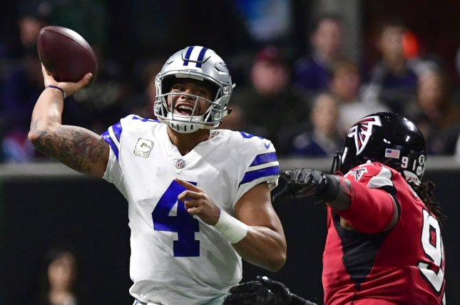 Dallas Cowboys quarterback Dak Prescott (4) is pressured by Atlanta Falcons defensive end Courtney Upshaw (91) during the first half of an NFL game at Mercedes Benz Stadium in Atlanta, November 12, 2017. File photo by Martin Tulis/UPI