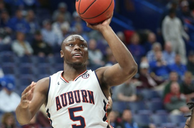 Auburn's Mustapha Heron shoots the basketball over the Alabama defense for two points in the first half of their SEC Tournament game on March 9, 2018 at the Scottrade Center in St. Louis. Photo by BIll Greenblatt/UPI