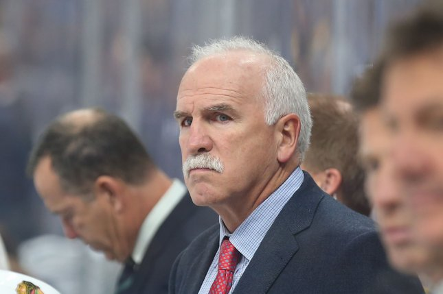 Former Chicago Blackhawks head coach Joel Quenneville watches his team against the St. Louis Blues in the first period on October 6 at the Enterprise Center in St. Louis. Photo by Bill Greenblatt/UPI