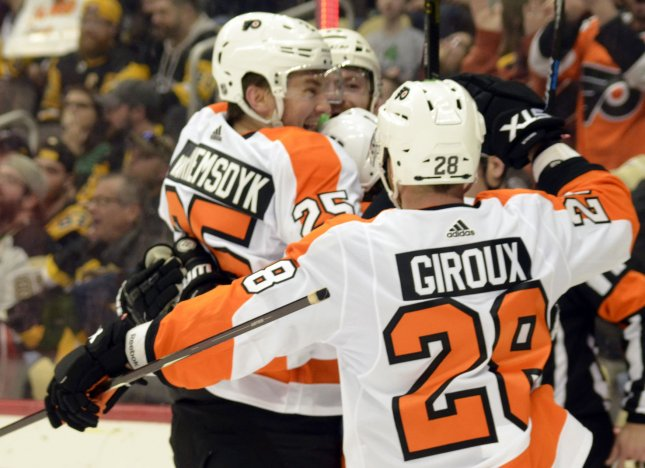 Philadelphia Flyers left wing James van Riemsdyk (25) scored and forward Claude Giroux (28) assisted a game-tying goal in a playoff win over the New York Islanders Thursday in Toronto. File Photo by Archie Carpenter/UPI