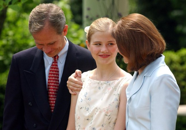 WAP2003043005 - WASHINGTON, April 30 (UPI) -- Edward, Elizabeth and Lois Smart, left to right, attend a ceremony in the Rose Garden of the White House where President Bush signed the Protect Act of 2003, a national Amber Alert law, on April 30, 2003. Elizabeth was abducted and held for nine months. rlw/Roger L. Wollenberg UPI