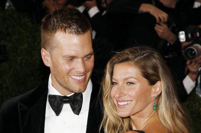 Gisele Bundchen (R) and husband Tom Brady celebrated their sixth wedding anniversary February 26, 2015. File photo by John Angelillo/UPI