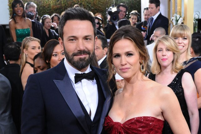 Ben Affleck (L) and wife Jennifer Garner at the Golden Globe Awards on January 13, 2013. The couple confirmed they will divorce in a joint statement Tuesday. File photo by Jim Ruymen/UPI