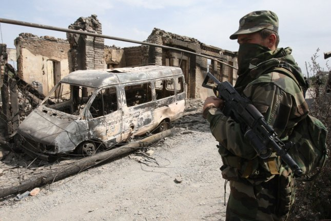 The International Criminal Court plans to open an investigation into possible crimes committed in the 2008 Russian-Georgian conflict, the first time Russia's actions will be investigated by the court. Pictured: Russian soldier looks at a destroyed van and ruins in the South Ossetian capital of Tskhinvali on August 14, 2008. File photo by Anatoli Zhdanov/UPI