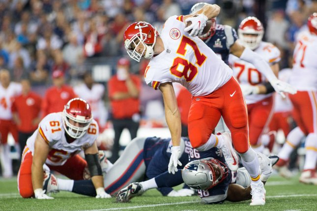 Kansas City Chiefs tight end Travis Kelce (87) dodges a tackle by New England Patriots defensive tackle Trey Flowers (98) on a seven-yard reception in the third quarter at Gillette Stadium in Foxborough, Massachusetts on September 7, 2017. File photo by Matthew Healey/UPI
