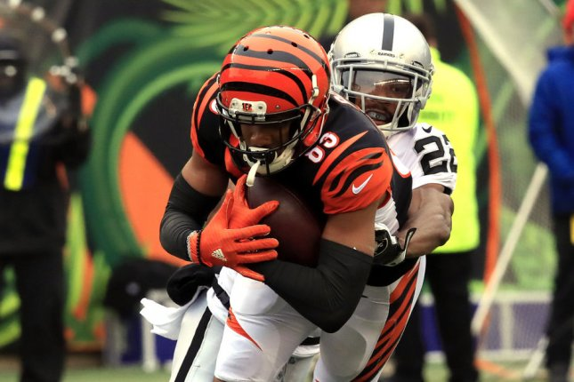 Cincinnati Bengals wide receiver Tyler Boyd is tacked by Oakland Raiders defensive back Rashaan Melvin during their game at Paul Brown Stadium on December 16, 2018. Photo by John Sommers II /UPI
