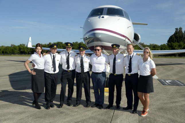 The Flight Crew stands in front of a Qatar Airways Executive Gulfstream G650ER at the Space Florida Launch and Landing Facility at Kennedy Space Center, Fla., on Thursday. Photo by Joe Marino/UPI