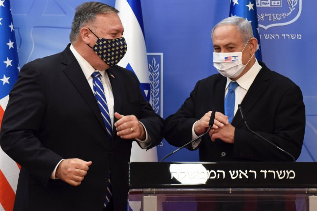 U.S. Secretary of State Mike Pompeo (L) bumps elbows with Israeli Prime Minister Benjamin Netanyahu during a visit in Jerusalem on August 24. File Photo by Debbie Hill/UPI
