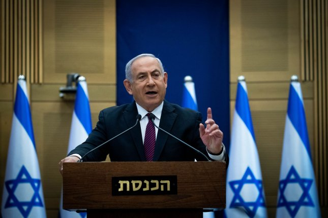 Israeli Prime Minister Benjamin Netanyahu delivers a statement as the Knesset approved a measure launching a process that may dissolve the unity government and force a fourth election in two years.  Pool Photo by Yonatan Sindel/UPI
