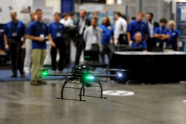 A small unmanned aerial vehicle is demonstrated by Procerus during the Association for Unmanned Vehicle Systems International (AUVSI) exhibit of products used for military, civil and first response applications in Washington, DC. (File/UPI/Roger L. Wollenberg)