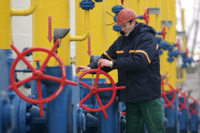 A Ukrainian worker operates at the natural gas pipeline from Russia to Poland in Boyarka town 15 miles from Kiev. (UPI Photo/Sergey Starostenko)