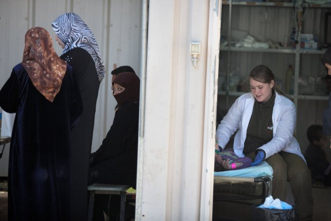 Dozens of Syrian children died Monday after being given tainted vaccines. UPI/Menahem Kahana/Pool