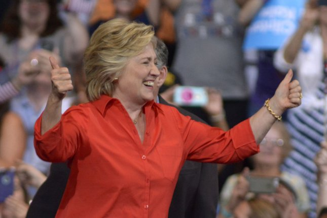 Democratic presidential candidate Hillary Clinton gives the thumbs up as she arrives at the David L. Lawrence Convention Center in Pittsburgh as part of a bus tour following the Democratic National Convention on Sunday. Her campaign reported bringing in more than $90 million in donations in the month of July. Photo by Archie Carpenter/UPI