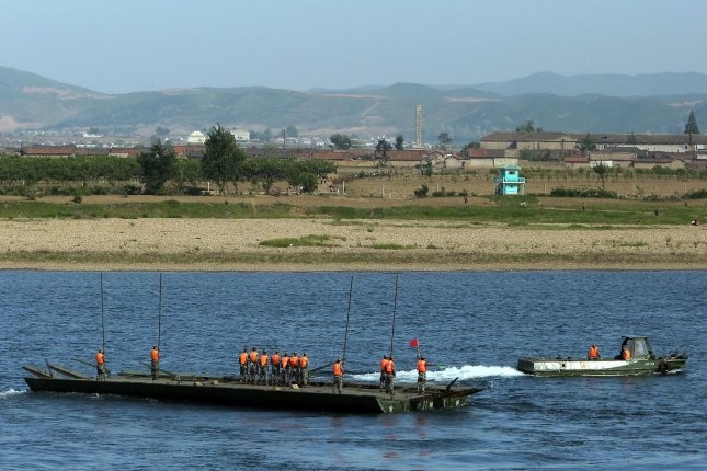 Chinese soldiers practice river crossing operations on the Yalu River on the North Korean river border. China is constructing a large-scale military facility in another region facing North Korea, according to a recent report. Photo by Stephen Shaver/UPI