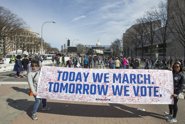 Participants of the March for Our Lives rally walk down Pennsylvania Avenue after the rally on March 24, 2018 in Washington, D.C. Hundreds of thousands rallied in the nation's capital to demand action to end gun violence and mass shootings in schools. Photo by Mark Wallheiser /UPI