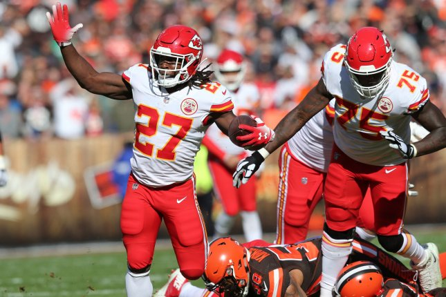 Kansas City Chiefs running back Kareem Hunt slips out of a tackle from Cleveland Browns defender Christian Kirksey in the first half on November 4 at First Energy Stadium in Cleveland. Photo by Aaron Josefczyk/UPI
