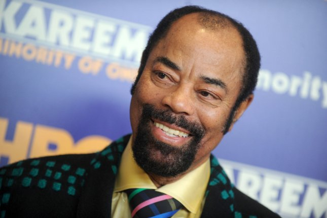 Former NBA player Walt Frazier arrives on the red carpet at the Kareem: Minority Of One New York premiere at Time Warner Center on October 26, 2015. He turns 75 on March 29. File Photo by Dennis Van Tine/UPI