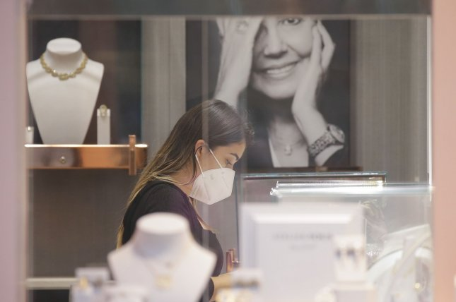 Researchers say that a new nasal spray could be a key tool to limit spread of COVID-19 this fall as people return to school and work -- including the pictured employee at a Tous retail store in Rockefeller Center in New York City on Sept. 1. Photo by John Angelillo/UPI