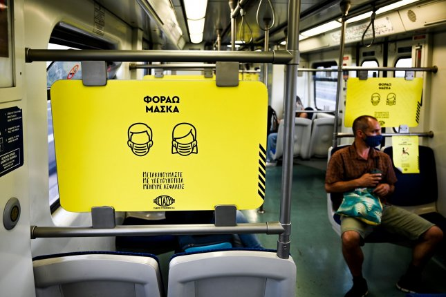 Signs on a subway inform riders that face masks are required for travel, in Athens, Greece, on August 7, 2020. File Photo by Thomas Maresca/UPI