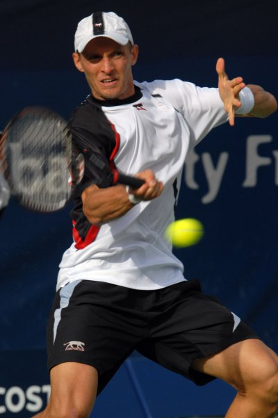 The world number five, Russia's Nikolay Davydenko returns the ball to Spain's Feliciano Lopez during the Semi finals of the Dubai Tennis Championships on Friday March 7, 2008. Lopez won the match 4-6 6-4 7-5. (UPI Photo/Norbert Schiller)