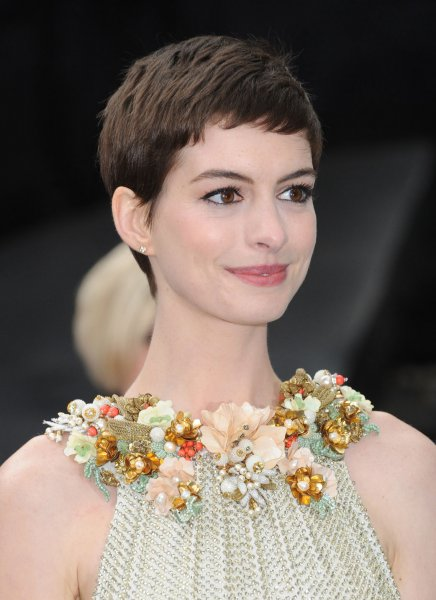 American actress Anne Hathaway attends the European premiere of The Dark Knight Rises at The Odeon and Empire Cinemas Leicester Square in London on July 18, 2012. UPI/Paul Treadway