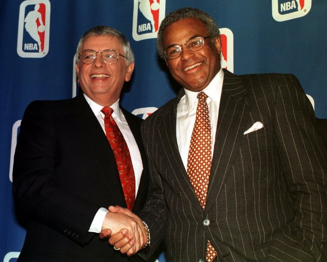 NBA Commissioner David Stern (L) and Players Association Executive Director Billy Hunter shake hands Jan. 7, 1999, during a New York City news conference to discuss an agreement reached the day before to end a six-month lockout. UPI/Ezio Petersen /File