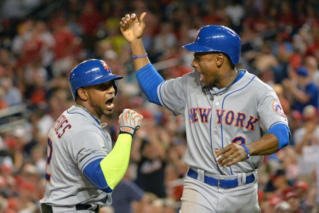New York Mets Yoenis Cespedes (L) celebrates with Curtis Granderson after Cespedes hit a two-run home run in the eighth inning against the Washington Nationals at Nationals Park in Washington, D.C. on September 9, 2015. The Mets defeated the Nationals 5-3. Photo by Kevin Dietsch/UPI