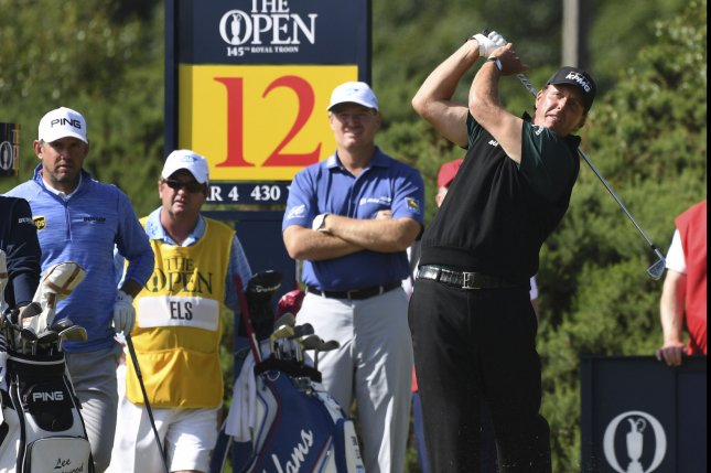 American golfer Phil Mickelson hits a tee shot on the 12th hole at the 145th Open Golf Championship in Troon, Scotland July 14, 2016. Photo by Hugo Philpott/UPI