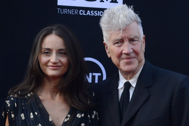 Director David Lynch (R) and wife Emily Stofle attend the 41st AFI Life Achievement Award tribute to Mel Brooks on June 6, 2013. Lynch appears as his Twin Peaks character Gordon Cole in a teaser. File Photo by Jim Ruymen/UPI