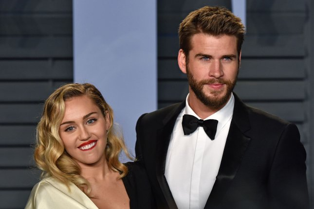 Miley Cyrus (L) and Liam Hemsworth went all out for their St. Patrick's Day celebration with friends. File Photo by Christine Chew/UPI