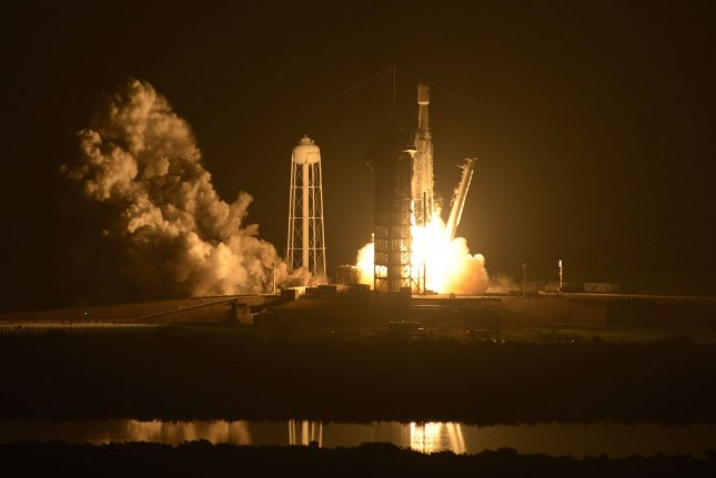 The SpaceX Falcon 9 Heavy rocket launches the STP-2 early Tuesday from Complex 39A at the Kennedy Space Center, Fla. The STP-2 payload consists of a cluster of 24 satellites for the U.S. Air Force, NASA and private industry. Photo by Joe Marino-Bill Cantrell/UPI