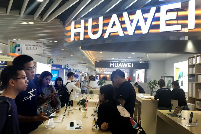Shoppers in Beijing check out the latest Huawei products in September. File Photo by Stephen Shaver/UPI