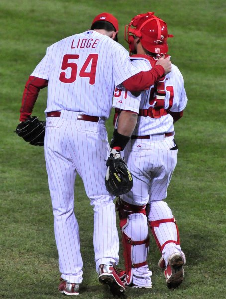 Brad Lidge talks with Philadelphia catcher Carlos Ruiz during the ninth inning of Game 4 of the World Series against the New York Yankees on Nov. 1, 2009. UPI Photo/Kevin Dietsch