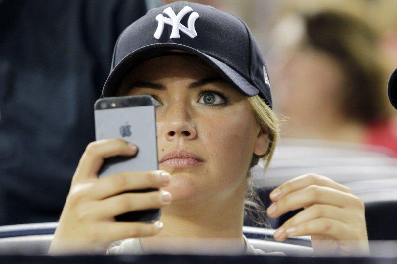 Kate Upton watches the Boston Red Sox play the New York Yankees at Yankee Stadium in New York City. UPI/John Angelillo
