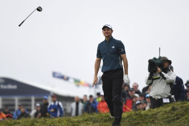 British golfer Justin Rose throws his club on the 4th hole at the 145th Open Golf Championship in Troon, Scotland July 15, 2016. Photo by Hugo Philpott/UPI