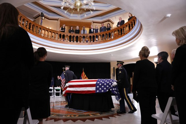 The Arizona National Guard carries the casket bearing Sen. John McCain into the museum rotunda during a memorial service Wednesday at the Arizona State Capitol in Phoenix. Pool Photo by Jae C. Hong/UPI
