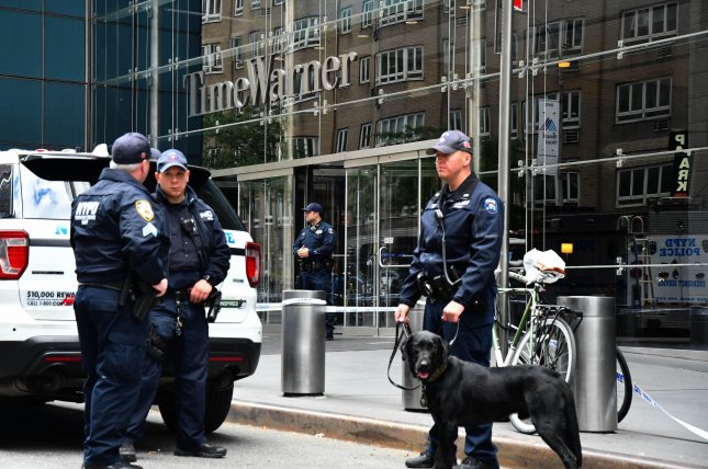Police stand outside the Time Warner Center after a suspicious package was found inside the CNN headquarters in New York City on Wednesday. Photo by Louis Lanzano/UPI