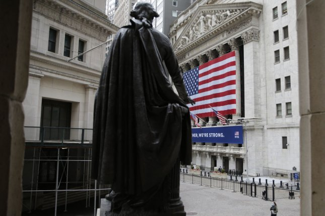 An American Flag hangs outside of the New York Stock Exchange on Wall Street in New York City on May 28. Photo by John Angelillo/UPI