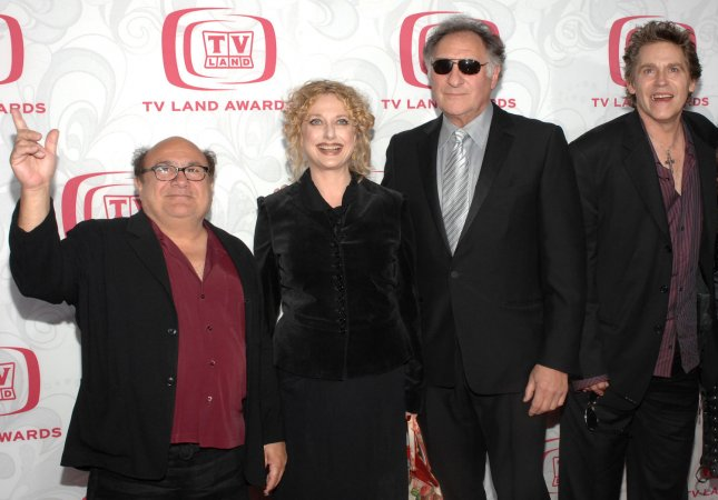 Actor Dannny DeVito waves as his fellow Taxi cast members Judd Hersch, Carol Kane and Jeff Conaway (L-R) gather during the 5th annual TV Land Awards at Barker Hanger in Santa Monica, California on April 14, 2007. (UPI Photo/Jim Ruymen)